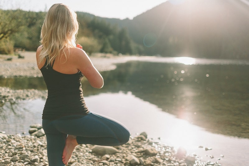 woman doing outdoor yoga - one of many forms of green exercise