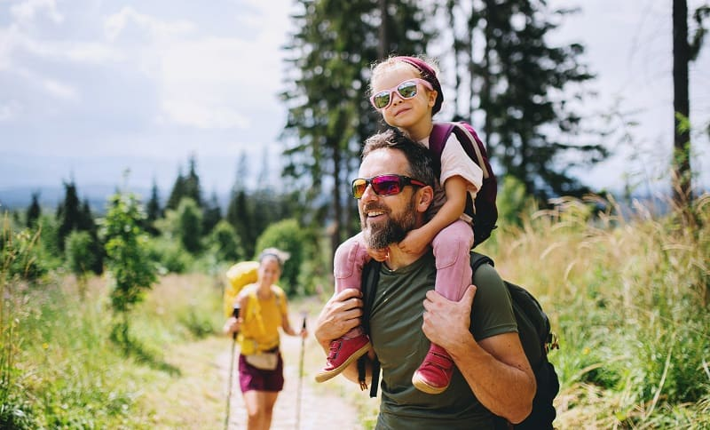 family on a hike in nature with their child