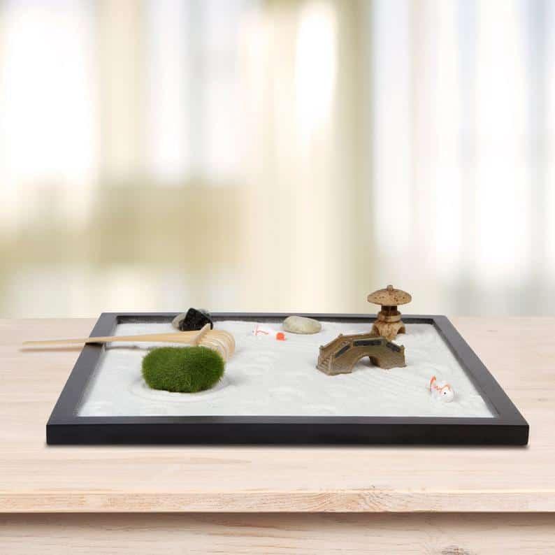 Asian inspired desktop zen kit on wooden table