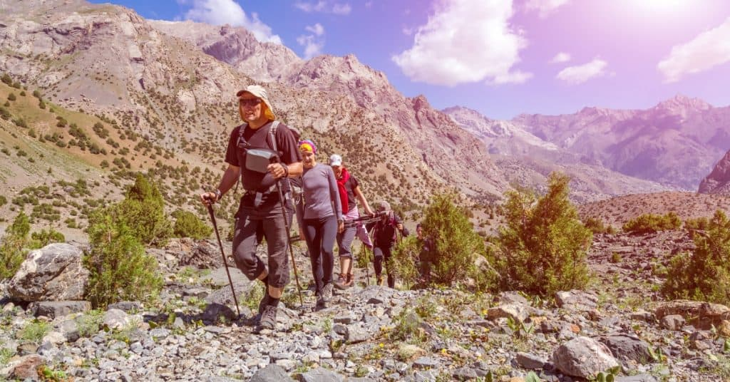 Guide leading hikers for wilderness therapy