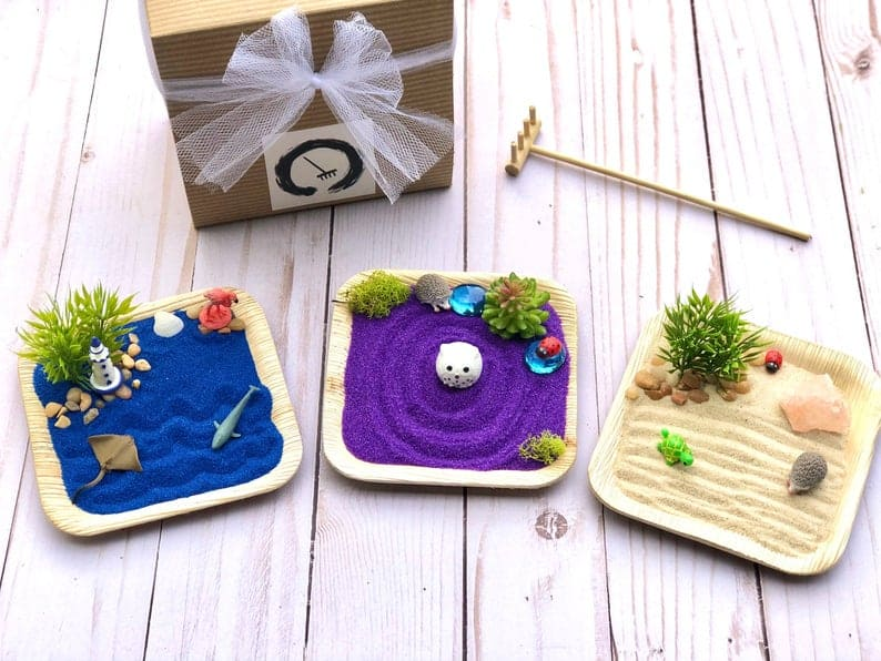 3 kids mini zen garden kits - blue sand with ocean theme, purple sand with an owl theme and desert sand with a turtle
