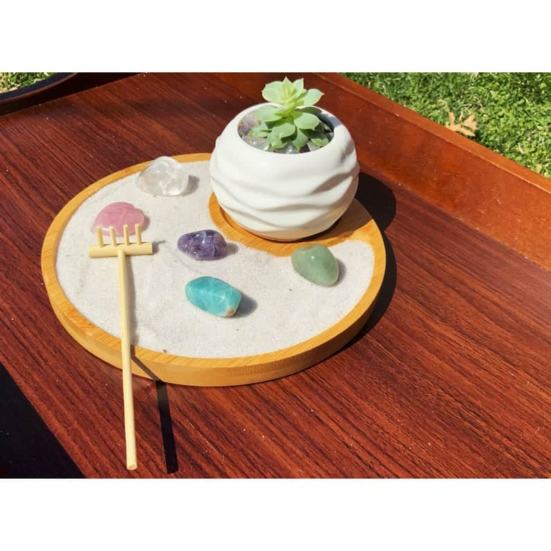 Round wooden zen garden kit with colorful crystals and a small succulant