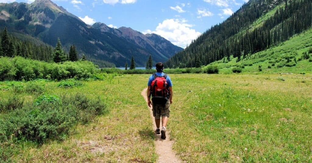 Teenager backpacking in the wilderness