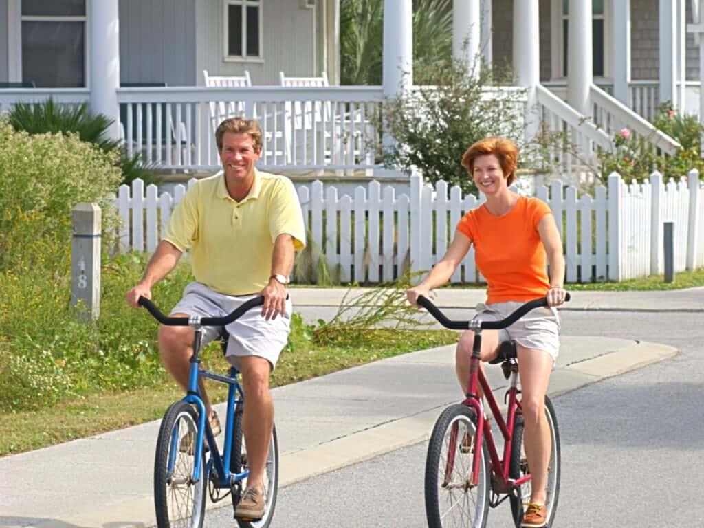 Man and woman biking in a neighborhood
