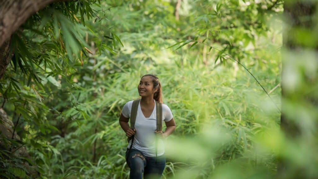 happy woman forest bathing